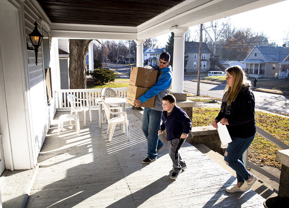 Brett Blakley, his son, Bentley, and daughter Makayla, make a delivery of food baskets from The State Journal-Register's Friend-in-Deed program to a residence on West Monroe Street Saturday, Dec. 22, 2018 in Springfield, Ill. [Rich Saal/The State Journal-Register]