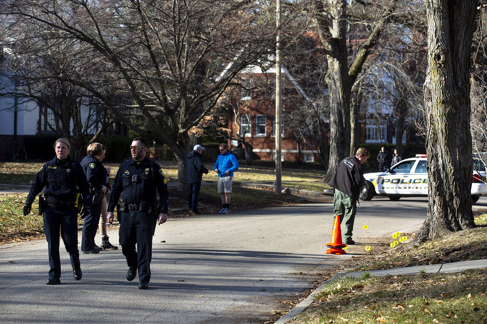 Springfield and Leland Grove police investigate the scene where gunshots were exchanged between two cars at the intersection of Leland and Wiggins avenues near Washington Park Saturday, Dec. 22, 2018 Springfield, Ill. [Rich Saal/The State Journal-Register]