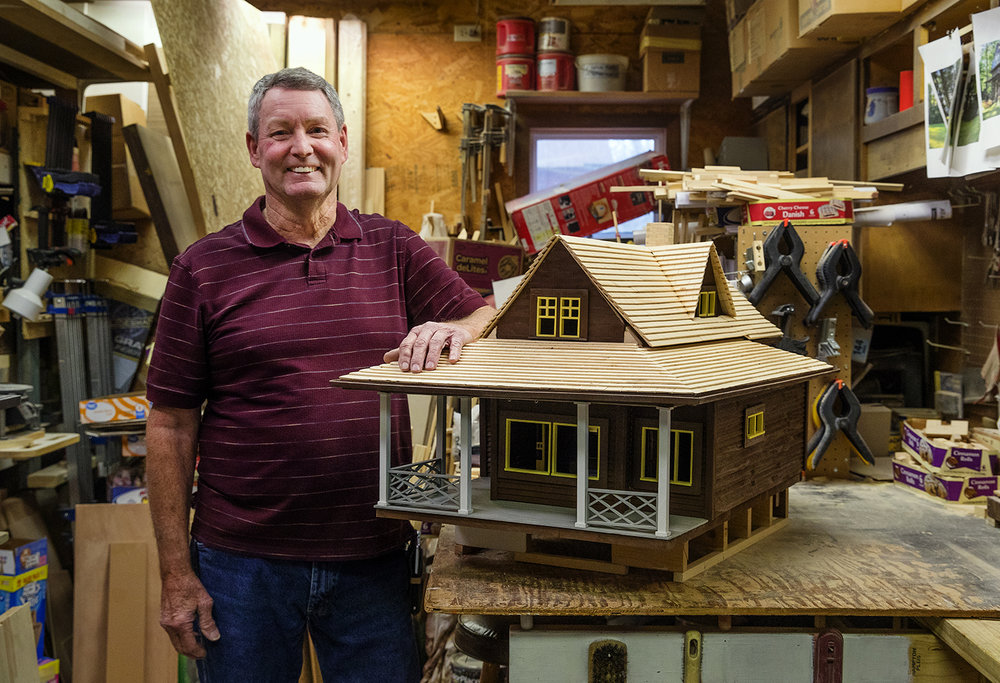 Glen Holliday re-created a cabin for his daughter's employer based on pictures and a few measurements. The 1/12 scale structure features a fireplace made with pea gravel, working french doors and even a wooden toilet. [Ted Schurter/The State Journal-Register]