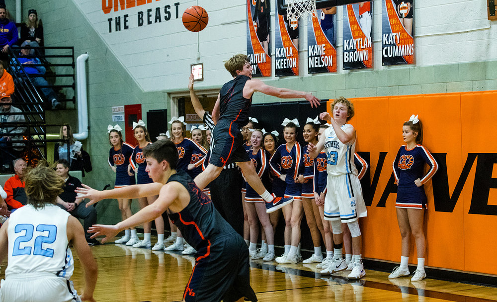 New Berlin's Zach Brewer pressures North Mac's Will Downs as he inbounds the ball during the Waverly Holiday Tournament Thursday, Dec. 27, 2018. [Ted Schurter/The State Journal-Register]
