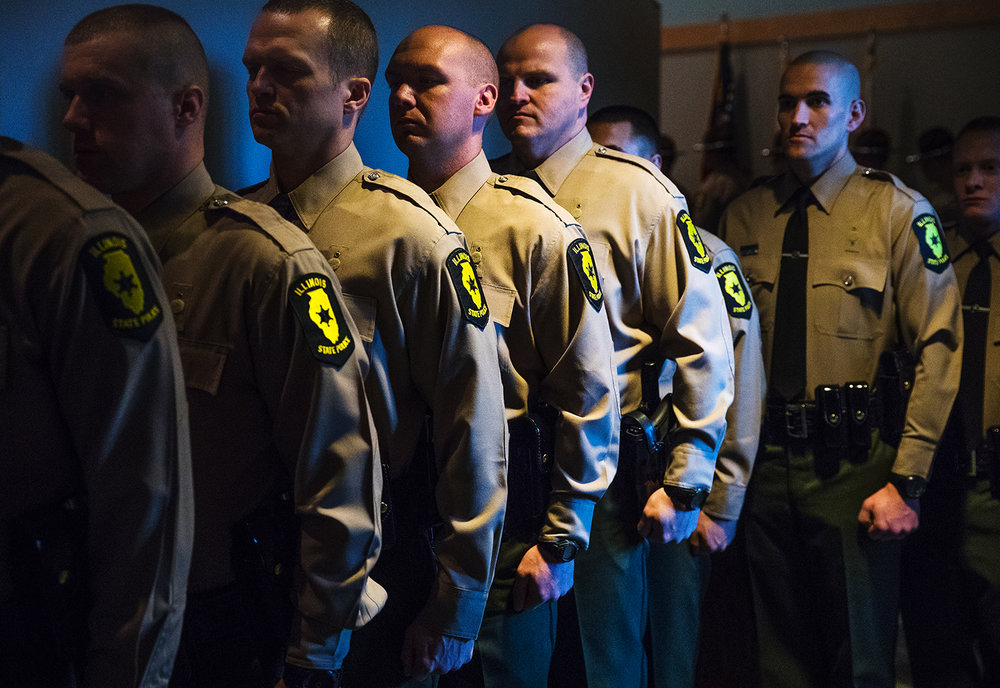 The Illinois State Police Cadet Class 128 waits for the beginning of their graduation ceremony at Hope Church Friday, Dec. 28, 2018. Fifty-nine Troopers received the oath of office during the ceremony. [Ted Schurter/The State Journal-Register]