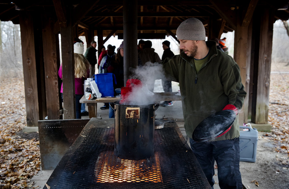 Scott Gauvin prepares one vegetable and one meat soup during the Sierra Club's annual Stone Soup Hike at Lincoln Memorial Garden Tuesday, Jan. 1, 2019. [Ted Schurter/The State Journal-Register]