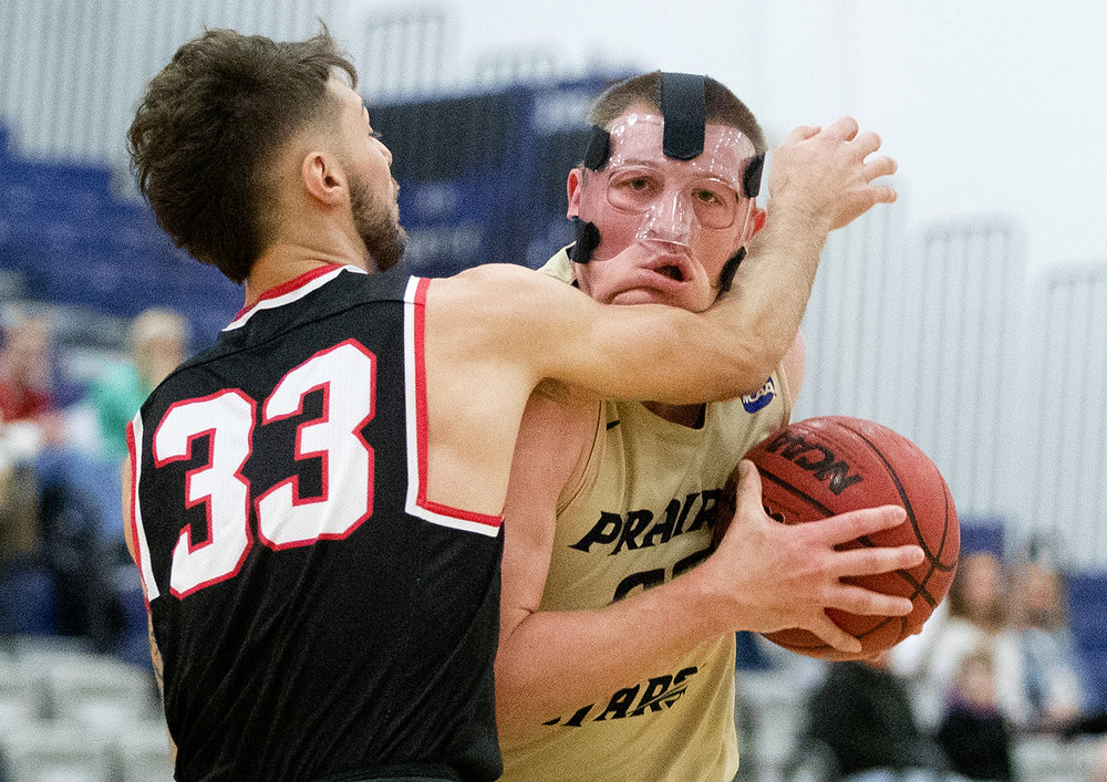 Lincoln Christian's Micah Davis pressures UIS' Peyton Allen at The Recreation and Athletic Center the Wednesday, Jan. 2, 2019. [Ted Schurter/The State Journal-Register]