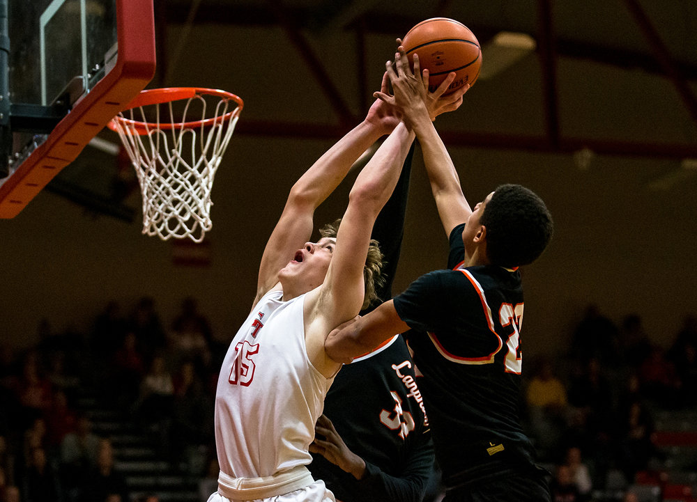 Glenwood's Eli Vogler (15) goes for a rebound against Lanphier's Tye Banks (23) in the second half at Glenwood High School, Friday, Jan. 4, 2019, in Chatham, Ill. [Justin L. Fowler/The State Journal-Register]
