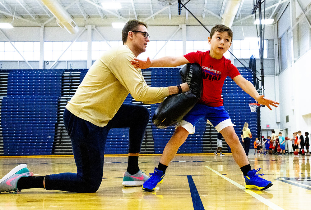 Michael Young learns how to box out during a drill with University of Illinois mens basketball player Zach Steinberg during The Prairie Stars Basketball Holiday Clinic at The Recreation and Activities Center (TRAC) on the UIS campus, Monday, Dec. 31, 2018, in Springfield, Ill. More than 80 boys and girls participated in the two-hour clinic, which was lead by players from the Prairie Stars' mens and women's teams. [Rich Saal/The State Journal-Register]