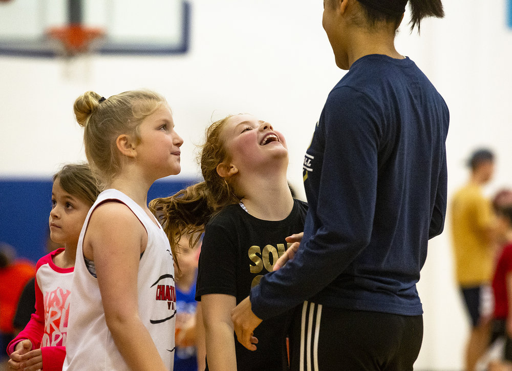 Addison Matthews, left, and Brooke Hutchison chat up Jasmine Sangster of The University of Illinois women's basketball team during The Prairie Stars Basketball Holiday Clinic at The Recreation and Activities Center (TRAC) on the UIS campus, Monday, Dec. 31, 2018, in Springfield, Ill. [Rich Saal/The State Journal-Register]