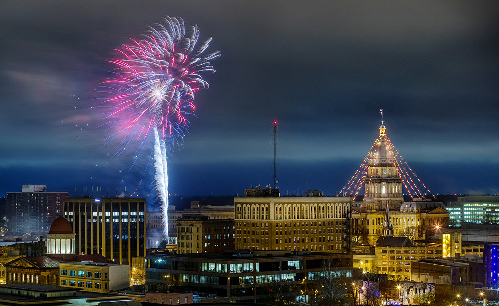 Fireworks from the First Night Springfield New Year's Eve celebration in downtown Springfield explode above the skyline Monday, Dec. 31, 2018. [Ted Schurter/The State Journal-Register]