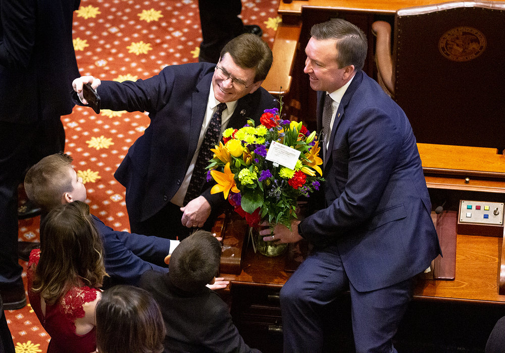 Springfield Mayor Jim Langfelder grabs a photo of himself with Sen. Andy Manar, D-Bunker Hill, before the inauguration of the Illinois State Senate of the 101st General Assembly Wednesday, Jan. 9, 2019 at the Capitol in Springfield, Ill. [Rich Saal/The State Journal-Register]