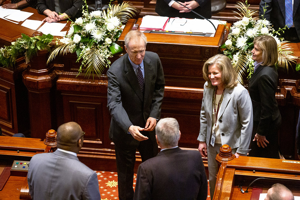 Gov. Bruce Rauner greets members of the senate escort committee before leaving the senate chamber after the inauguration of the Illinois State Senate of the 101st General Assembly Wednesday, Jan. 9, 2019 at the Capitol in Springfield, Ill. [Rich Saal/The State Journal-Register]