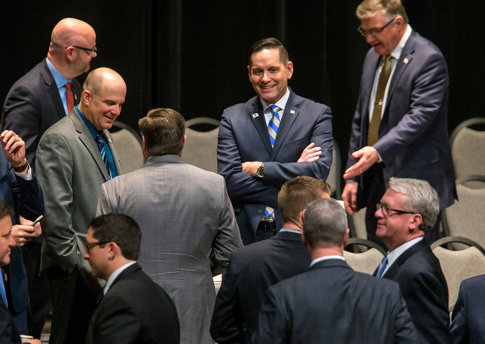 Illinois Rep. Tim Butler, R-Springfield, center, mingles with members of the Illinois House during the inauguration ceremony for the Illinois House of Representatives for the 101st General Assembly at the University of Illinois Springfield's Sangamon Auditorium, Wednesday, Jan. 9, 2019, in Springfield, Ill. [Justin L. Fowler/The State Journal-Register]