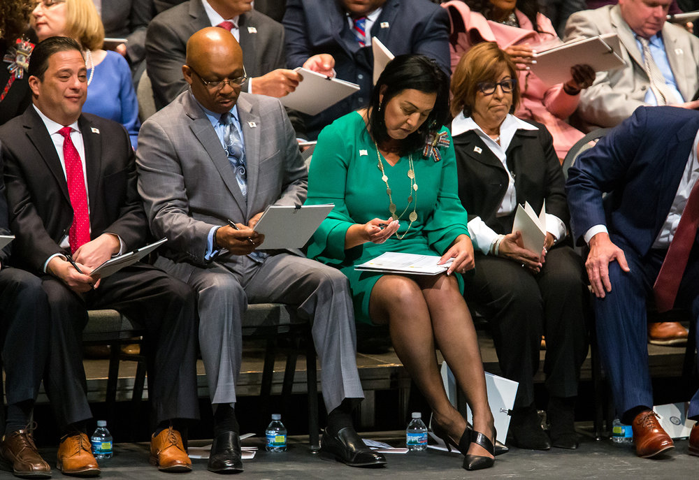 Illinois State Rep. Linda Chapa LaVia, D-Aurora, center, joins her fellow members of the House filling out the official paperwork as they sworn in during the inauguration ceremony for the Illinois House of Representatives for the 101st General Assembly at the University of Illinois Springfield's Sangamon Auditorium, Wednesday, Jan. 9, 2019, in Springfield, Ill. [Justin L. Fowler/The State Journal-Register]