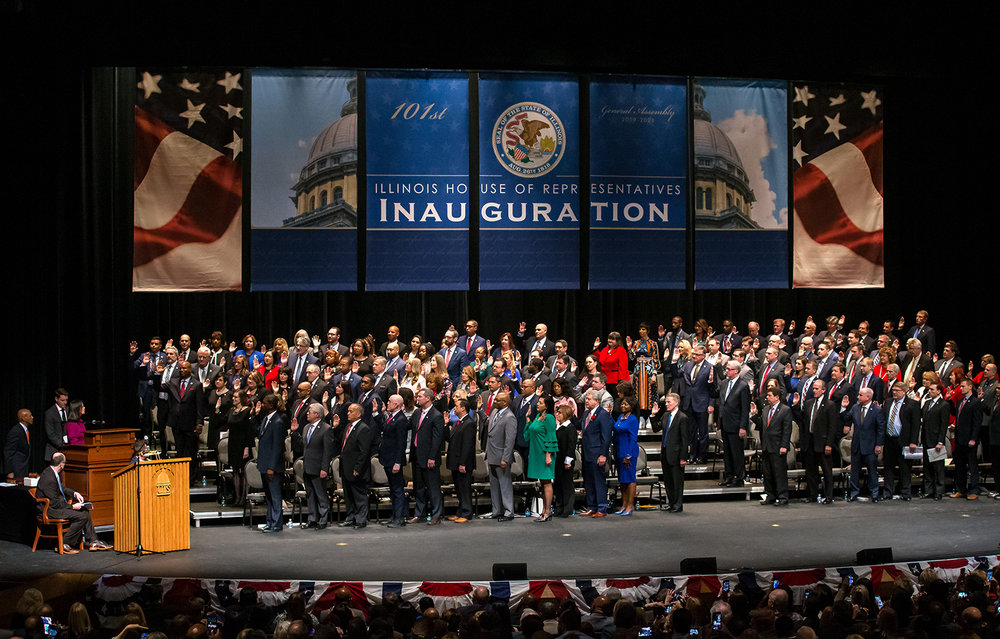 Members of the Illinois House are sworn in by Illinois Attorney General Lisa Madigan during the inauguration ceremony for the Illinois House of Representatives for the 101st General Assembly at the University of Illinois Springfield's Sangamon Auditorium, Wednesday, Jan. 9, 2019, in Springfield, Ill. [Justin L. Fowler/The State Journal-Register]