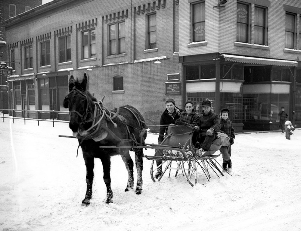 James McDonald, left, Edward Arn and George Peddicord, behind Skeezix the mule, ply the streets downtown after nine inches of snow Jan. 7, 1940. The young boy, right, is Joe Shea. The group was photographed in front of The Dew chilli parlor, in the alley behind the downtown federal building and post office. File/The State Journal-Register