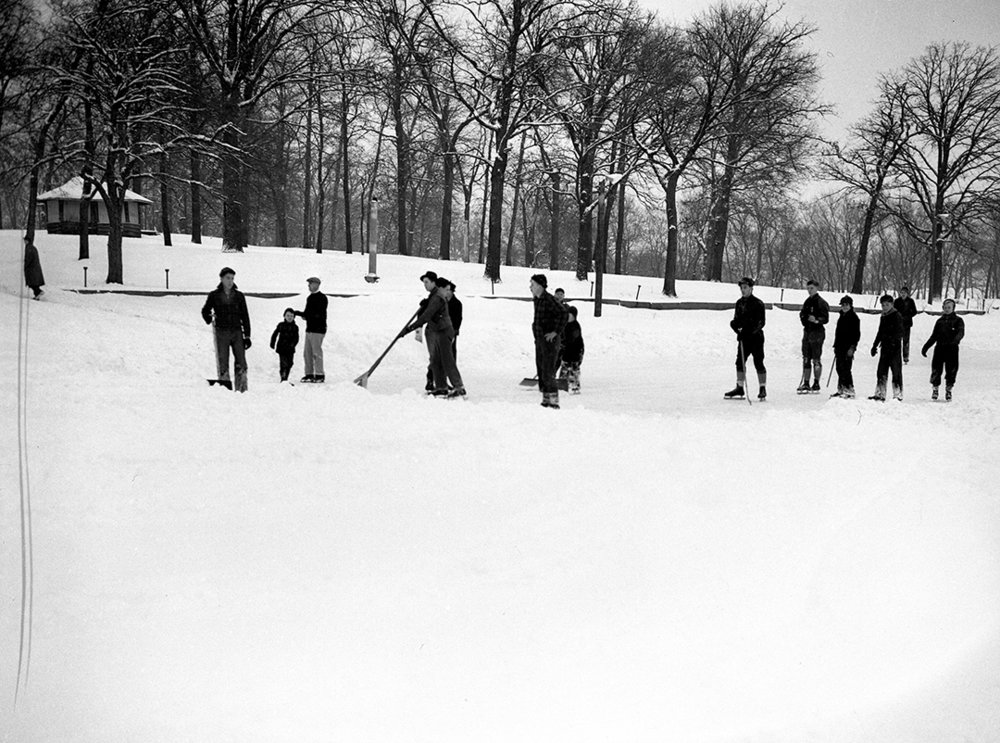 Skaters at Bunn Park clear snow from pond after nine inches of snow Jan. 7, 1940. File/The State Journal-Register