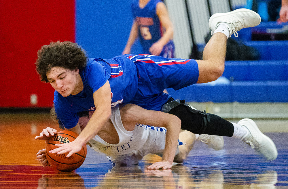 Pleasant Plains' Gage Bartos dives over Lutheran's JT Wiegand to secure a loose ball during the Sangamon County High School Basketball Tournament at Lincoln Land Community College Thursday, Jan. 10, 2019. [Ted Schurter/The State Journal-Register]