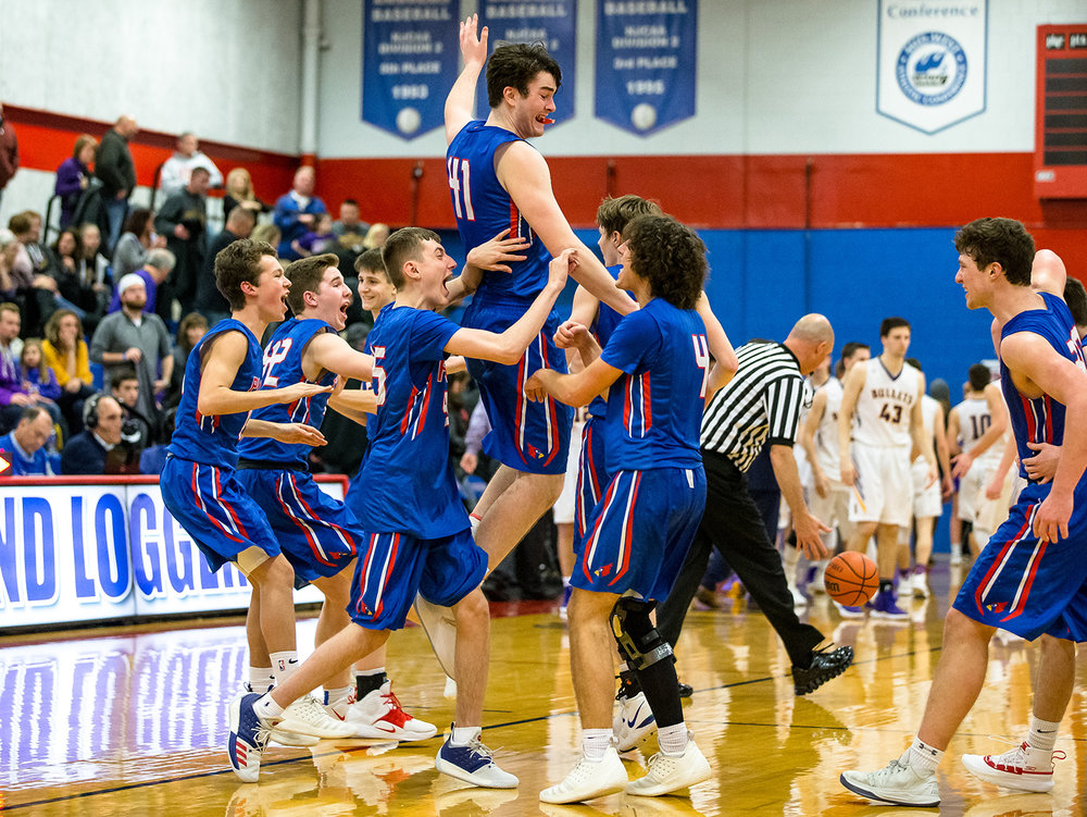 Pleasant Plains' Chase Schmitt (41) leaps up to celebrate with his teammates after the Cardinals defeated Williamsville in Boys Sangamon County Tournament championship game at Lincoln Land Community College's Cass Gymnasium, Friday, Jan. 11, 2019, in Springfield, Ill. [Justin L. Fowler/The State Journal-Register]