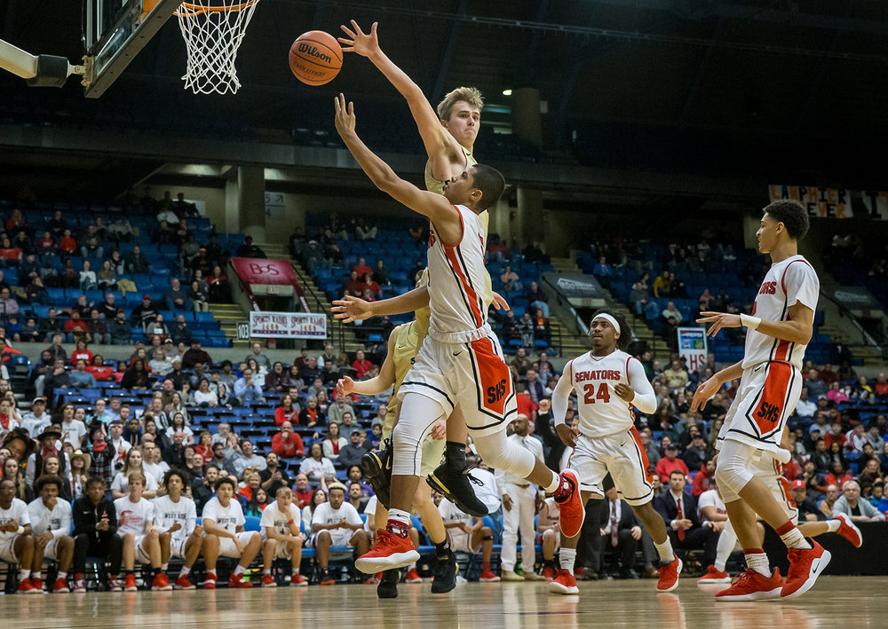 Springfield's Shane Miller (5) tries to swing a shot around Sacred Heart-Griffin's Joe Gustafson (2) in the fourth quarter on opening night of the Boys City Tournament at the Bank of Springfield Center, Wednesday, Jan. 16, 2019, in Springfield, Ill. [Justin L. Fowler/The State Journal-Register]