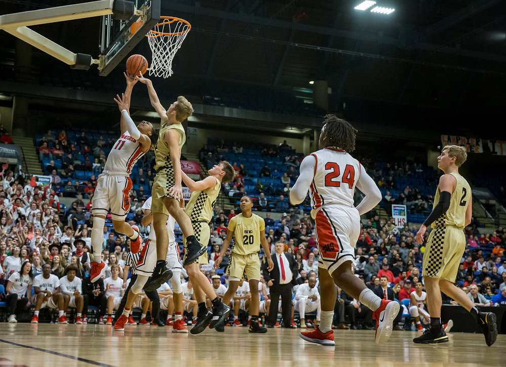 Springfield's Zaire Harris (11) puts up a shot against Sacred Heart-Griffin's Charlie Hamilton (4) in the fourth quarter on opening night of the Boys City Tournament at the Bank of Springfield Center, Wednesday, Jan. 16, 2019, in Springfield, Ill. [Justin L. Fowler/The State Journal-Register]