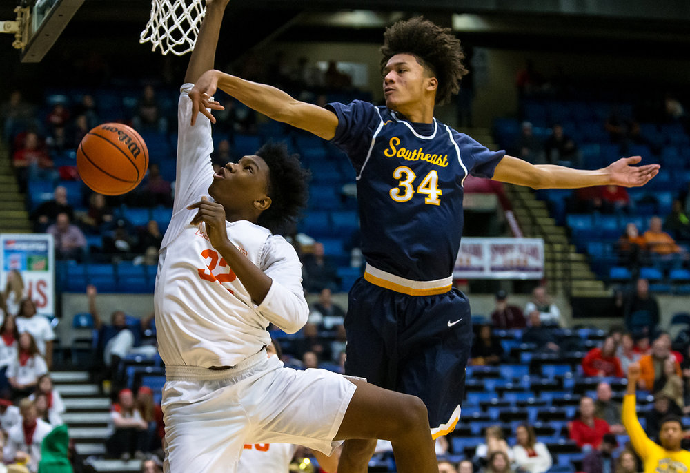 Lanphier's KJ Debrick (32) has his shot blocked by Southeast's Michael Tyler (34) in the second quarter on opening night of the Boys City Tournament at the Bank of Springfield Center, Wednesday, Jan. 16, 2019, in Springfield, Ill. [Justin L. Fowler/The State Journal-Register]