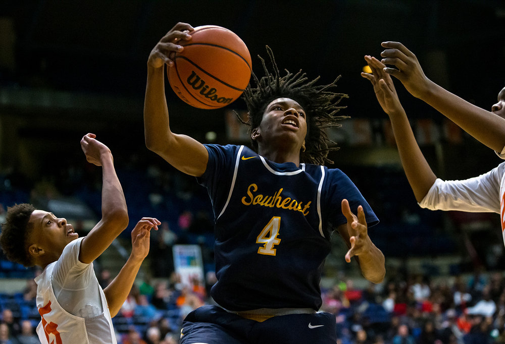 Southeast's Terrion Murdix (4) pulls in a rebound against Lanphier's Maki Rose (15) in the third quarter on opening night of the Boys City Tournament at the Bank of Springfield Center, Wednesday, Jan. 16, 2019, in Springfield, Ill. [Justin L. Fowler/The State Journal-Register]
