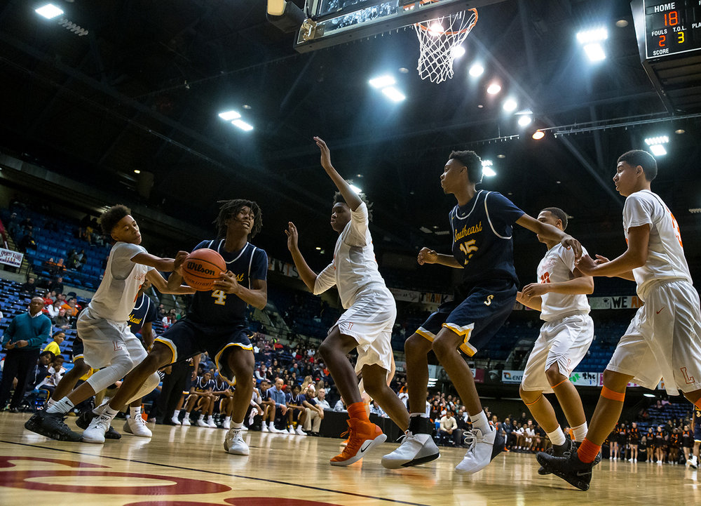 Southeast's Terrion Murdix (4) drives up to the basket against Lanphier's KJ Debrick (32) in the third quarter on opening night of the Boys City Tournament at the Bank of Springfield Center, Wednesday, Jan. 16, 2019, in Springfield, Ill. [Justin L. Fowler/The State Journal-Register]