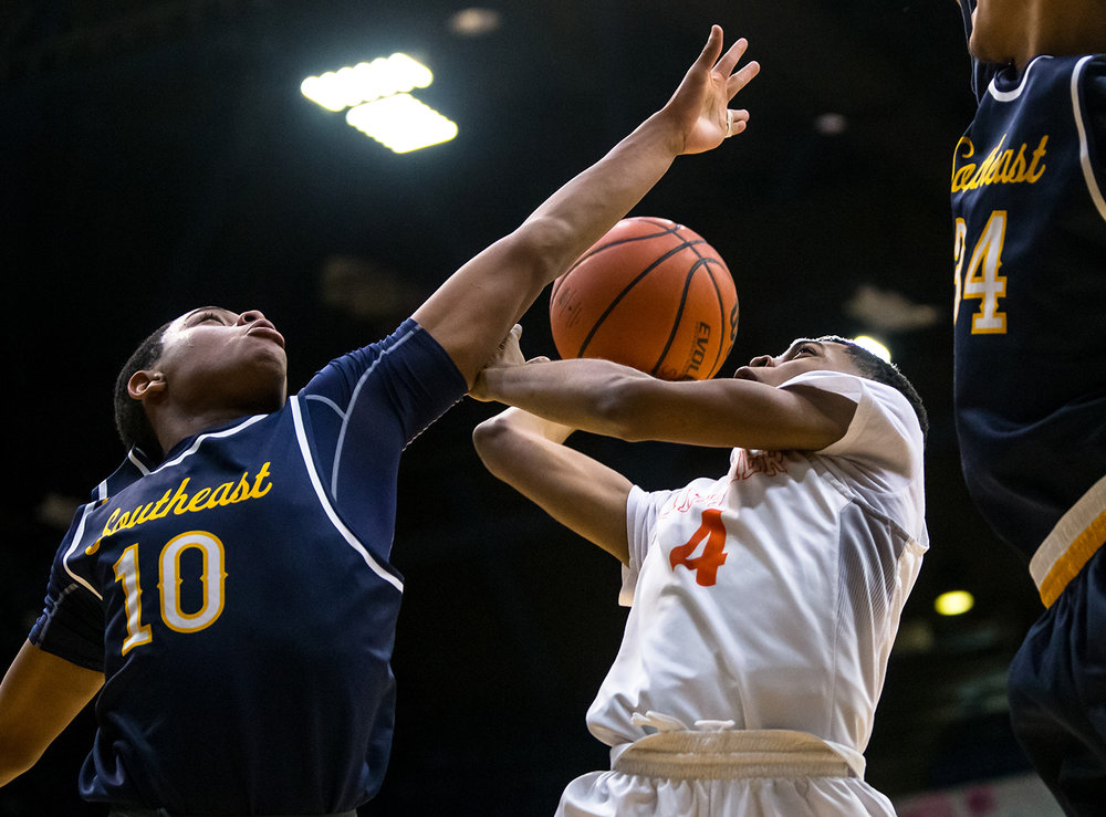 Lanphier's Larry Hemingway (4) drives up to the basket against Southeast's Damon Davis (10) in the first quarter on opening night of the Boys City Tournament at the Bank of Springfield Center, Wednesday, Jan. 16, 2019, in Springfield, Ill. [Justin L. Fowler/The State Journal-Register]