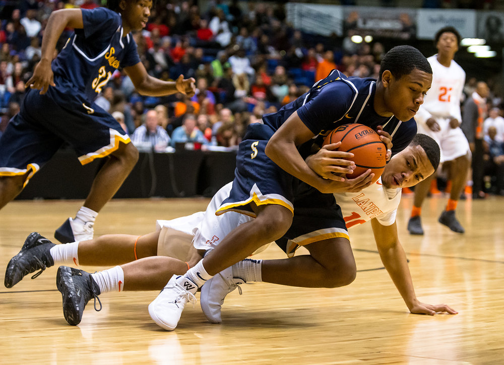 Southeast's Damon Davis (10) hits the floor with Lanphier's Shain Chairs (10) as they battle for a loose ball in the second quarter on opening night of the Boys City Tournament at the Bank of Springfield Center, Wednesday, Jan. 16, 2019, in Springfield, Ill. [Justin L. Fowler/The State Journal-Register]