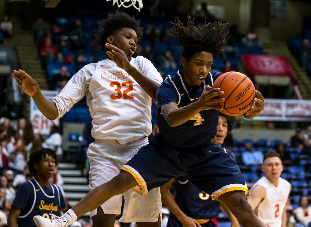 Southeast's Terrion Murdix (4) pulls in a rebound against Lanphier's KJ Debrick (32) in the second quarter on opening night of the Boys City Tournament at the Bank of Springfield Center, Wednesday, Jan. 16, 2019, in Springfield, Ill. [Justin L. Fowler/The State Journal-Register]