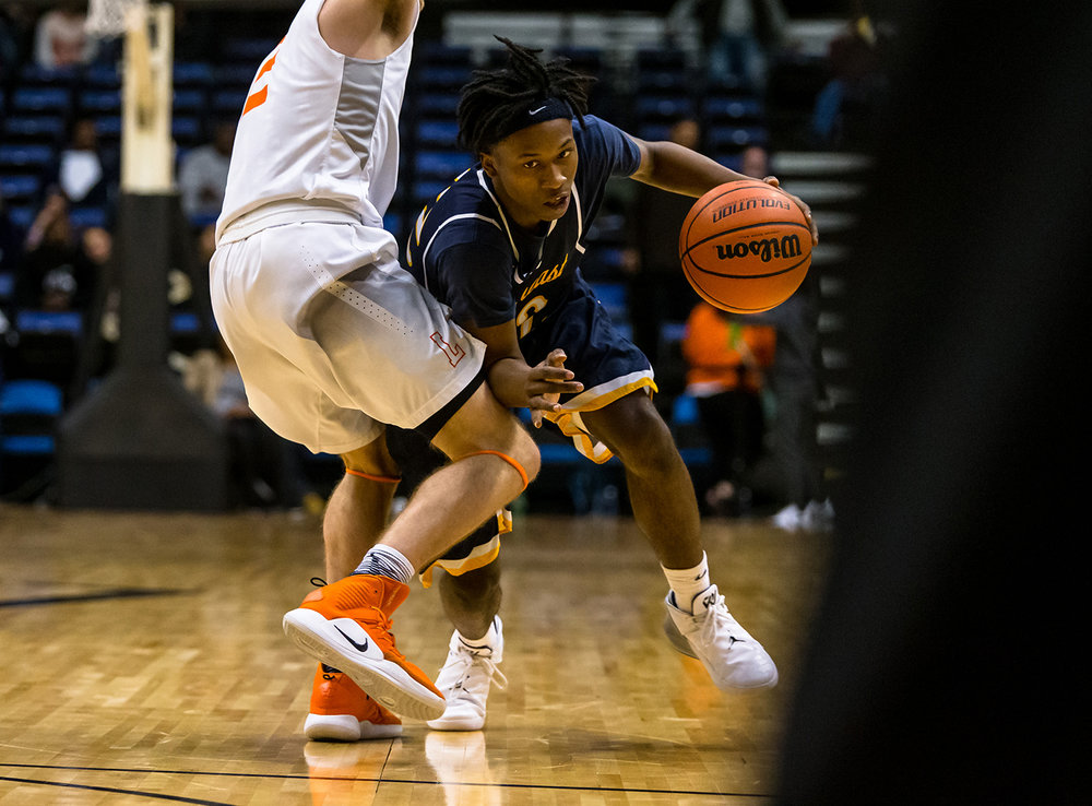 Southeast's Stepheon Sims (32) drives towards the basket against Lanphier's Jaden Snodgrass (2) in the third quarter on opening night of the Boys City Tournament at the Bank of Springfield Center, Wednesday, Jan. 16, 2019, in Springfield, Ill. [Justin L. Fowler/The State Journal-Register]