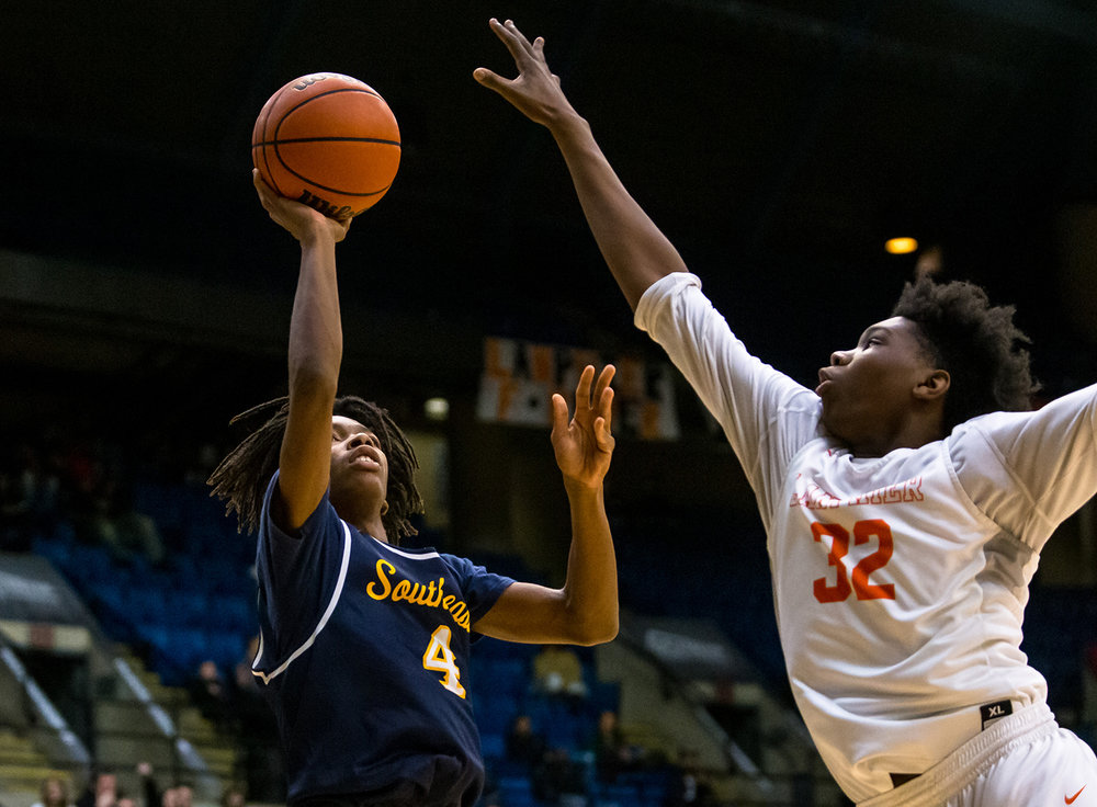 Southeast's Terrion Murdix (4) puts up a floater over Lanphier's KJ Debrick (32) in the third quarter on opening night of the Boys City Tournament at the Bank of Springfield Center, Wednesday, Jan. 16, 2019, in Springfield, Ill. [Justin L. Fowler/The State Journal-Register]