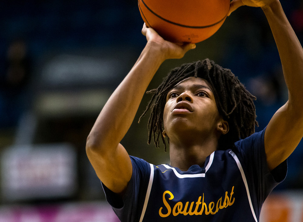 Southeast's Terrion Murdix (4) lines up a free throw against as the Spartans take on Lanphier in the fourth quarter on opening night of the Boys City Tournament at the Bank of Springfield Center, Wednesday, Jan. 16, 2019, in Springfield, Ill. [Justin L. Fowler/The State Journal-Register]