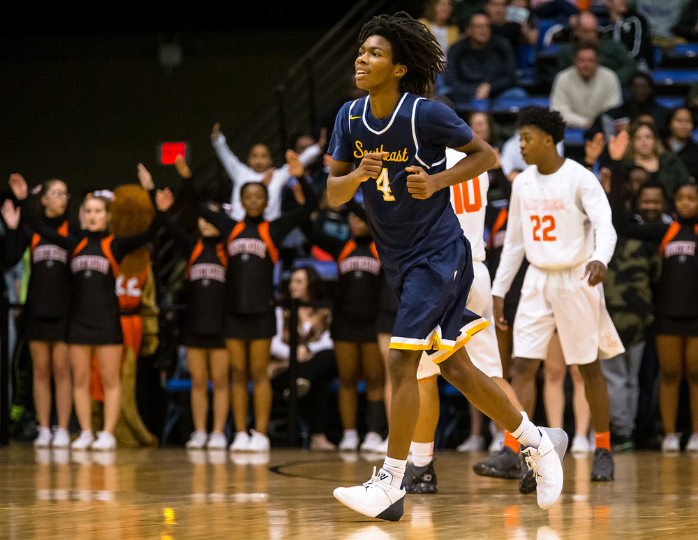 Southeast's Terrion Murdix (4) jogs off the court after scoring a basket on a fast break and forcing Lanphier to call a time out in the first quarter on opening night of the Boys City Tournament at the Bank of Springfield Center, Wednesday, Jan. 16, 2019, in Springfield, Ill. [Justin L. Fowler/The State Journal-Register]