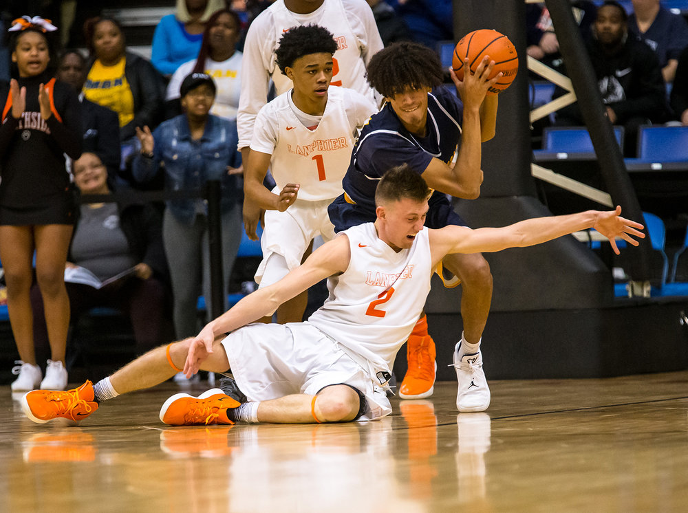 Southeast's Michael Tyler (34) snags a loose ball out of the grasp of Lanphier's Jaden Snodgrass (2) in the second quarter on opening night of the Boys City Tournament at the Bank of Springfield Center, Wednesday, Jan. 16, 2019, in Springfield, Ill. [Justin L. Fowler/The State Journal-Register]