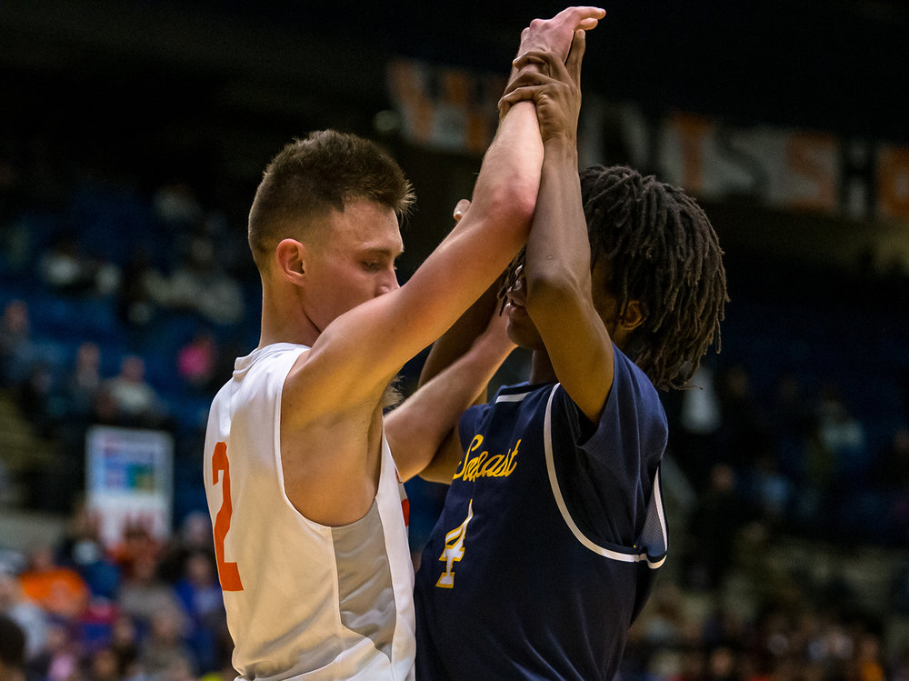 Lanphier's Jaden Snodgrass (2) and Southeast's Terrion Murdix (4) get tangled up before the whistle even blows on the inbounds pass in the second quarter on opening night of the Boys City Tournament at the Bank of Springfield Center, Wednesday, Jan. 16, 2019, in Springfield, Ill. [Justin L. Fowler/The State Journal-Register]