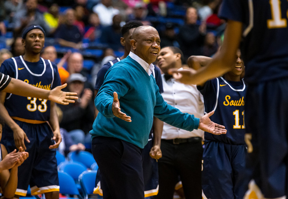 Southeast boys basketball head coach Lawrence Thomas as for a reason for Southeast's James Dent (15) being called for his second technical as the Spartans take on Lanphier in the fourth quarter on opening night of the Boys City Tournament at the Bank of Springfield Center, Wednesday, Jan. 16, 2019, in Springfield, Ill. [Justin L. Fowler/The State Journal-Register]