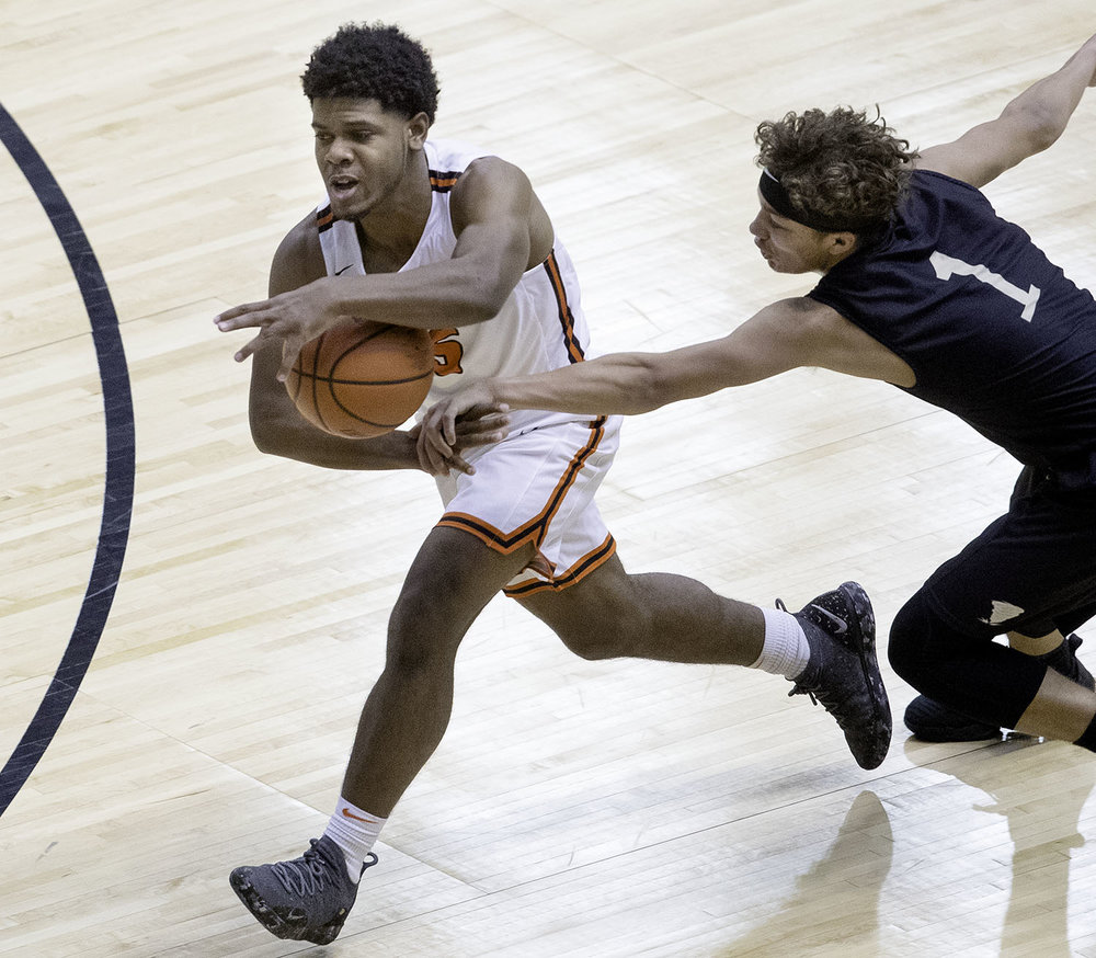 Sacred Heart-Griffin's Isaiah Thompson fouls Lanphier's Stanley Morgan  during the Boys City Tournament at the Bank of Springfield Center Thursday, Jan. 17, 2019.  [Ted Schurter/The State Journal-Register]