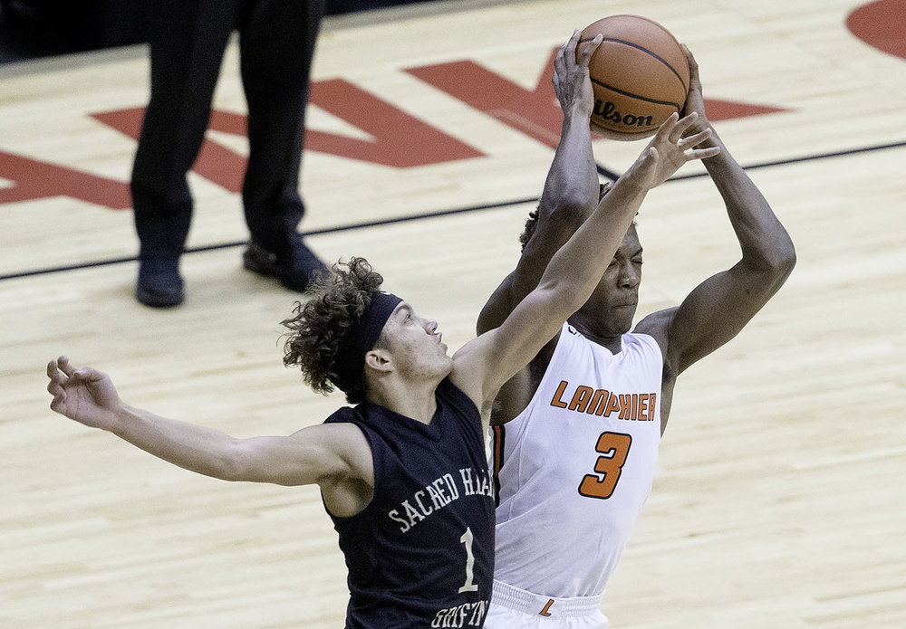 Lanphier's Karl Wright grabs a rebound in front of Sacred Heart-Griffin's Isaiah Thompson during the Boys City Tournament at the Bank of Springfield Center Thursday, Jan. 17, 2019.  [Ted Schurter/The State Journal-Register]