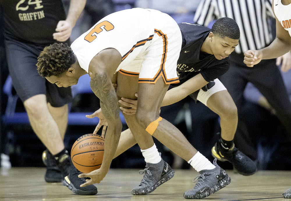 Sacred Heart-Griffin's Andrew Schluter fouls Lanphier's Karl Wright during the Boys City Tournament at the Bank of Springfield Center Thursday, Jan. 17, 2019.  [Ted Schurter/The State Journal-Register]