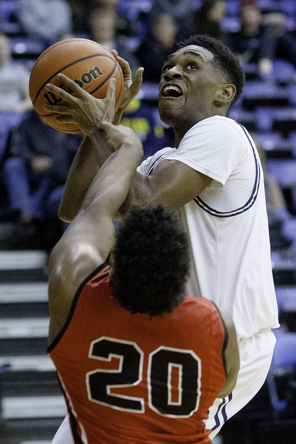 Southeast's Jayden Hayes drives into Springfield's Caleb Small during the Boys City Tournament at the Bank of Springfield Center Thursday, Jan. 17, 2019.  [Ted Schurter/The State Journal-Register]