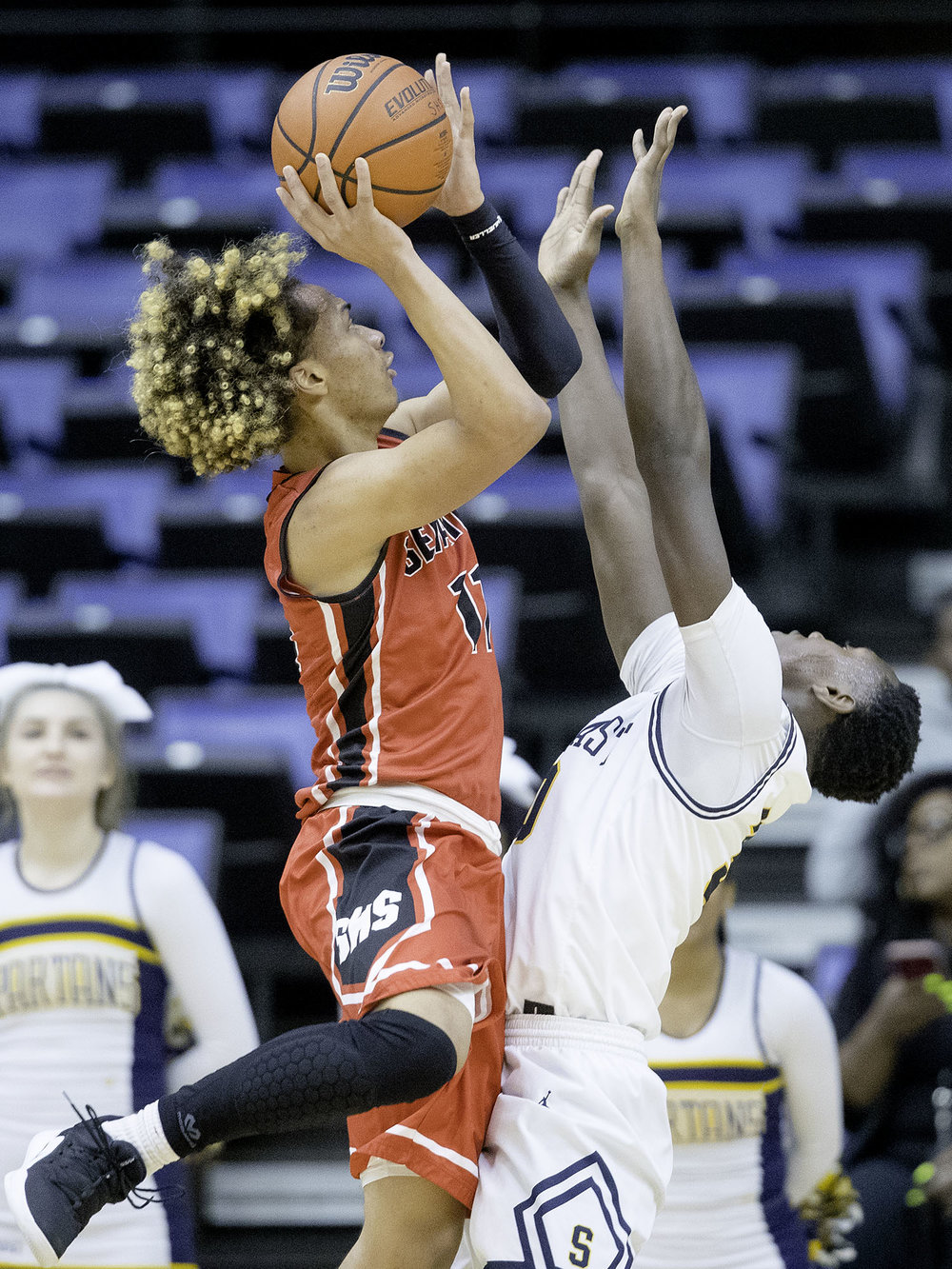 Springfield's Zaire Harris puts up a shot under pressure from a Southeast defender during the Boys City Tournament at the Bank of Springfield Center Thursday, Jan. 17, 2019.  [Ted Schurter/The State Journal-Register]