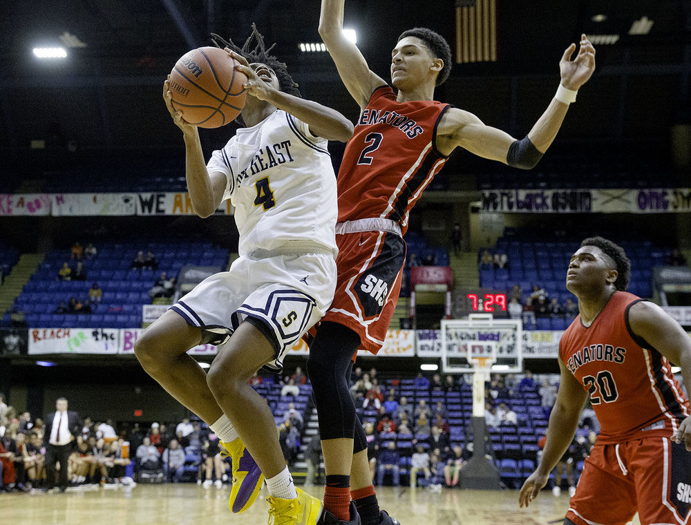 Southeast's Terrion Murdix drives into Springfield's Bennie Slater during the Boys City Tournament at the Bank of Springfield Center Thursday, Jan. 17, 2019.  [Ted Schurter/The State Journal-Register]