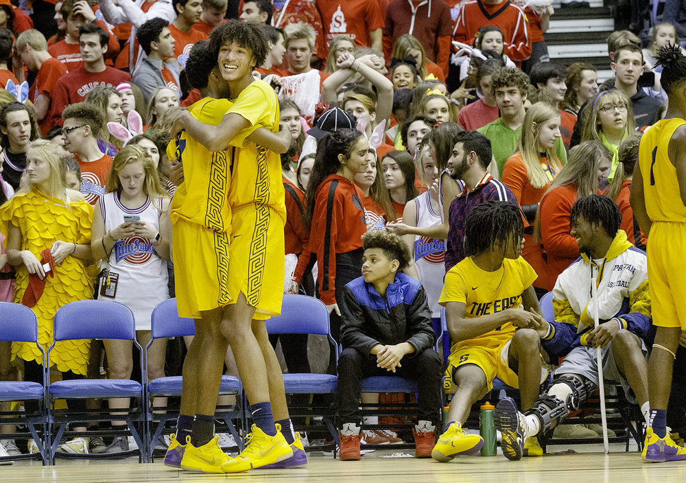 Southeast's James Dent hugs Southeast's Michael Taylor as time winds down in the Spartans win against Sacred Heart-Griffin during the Boys City Tournament at the Bank of Springfield Center Friday, Jan. 18, 2019.  [Ted Schurter/The State Journal-Register]