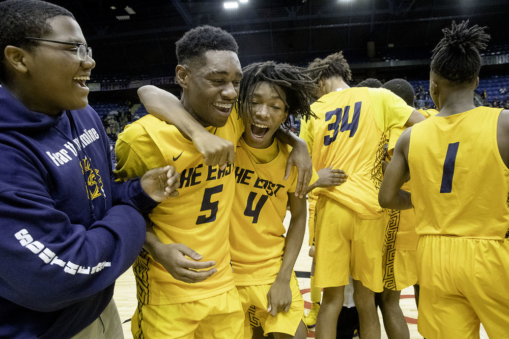 Southeast's Jayden Hayes and Terrion Murdix celebrate after the Spartans defeated Sacred Heart-Griffin during the Boys City Tournament at the Bank of Springfield Center Friday, Jan. 18, 2019.  [Ted Schurter/The State Journal-Register]
