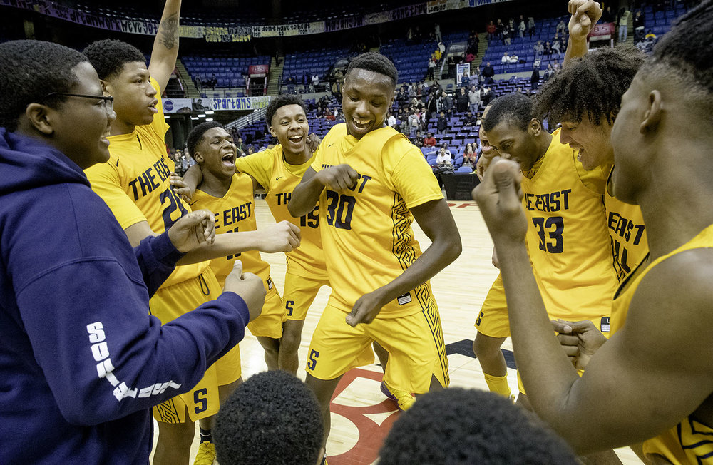 Southeast's Devin Blue-Robinson and the Spartans celebrate after defeating Sacred Heart-Griffin during the Boys City Tournament at the Bank of Springfield Center Friday, Jan. 18, 2019.  [Ted Schurter/The State Journal-Register]