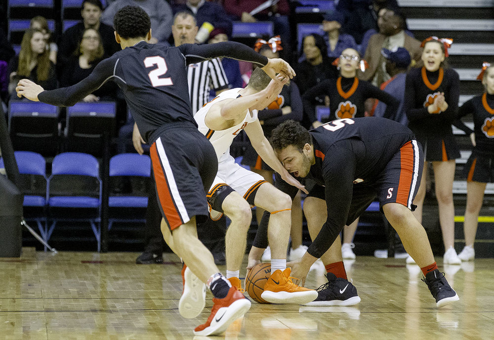 Springfield's Nate Borders grabs a loose ball in front of Jaden Snodgrass during the Boys City Tournament at the Bank of Springfield Center Friday, Jan. 18, 2019.  [Ted Schurter/The State Journal-Register]