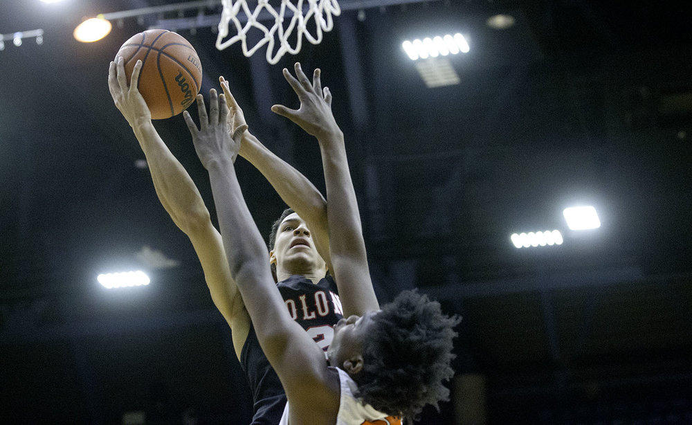 Springfield's Bennie Slater shoots over Lanphier's KJ Deberick during the Boys City Tournament at the Bank of Springfield Center Friday, Jan. 18, 2019.  [Ted Schurter/The State Journal-Register]