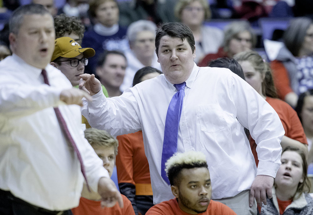 A Springfield fan imitates Springfield head coach Joby Crum during the Boys City Tournament at the Bank of Springfield Center Friday, Jan. 18, 2019.  [Ted Schurter/The State Journal-Register]