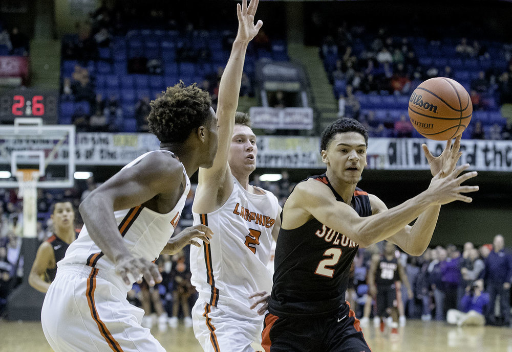 Springfield's Bennie Slater momentarily looses control of the ball as he drives to the hoop in the finals seconds of the Senators loss to Lanphier during the Boys City Tournament at the Bank of Springfield Center Friday, Jan. 18, 2019.  [Ted Schurter/The State Journal-Register]
