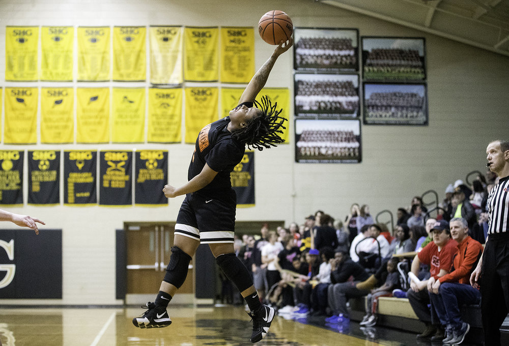 Lanphier's Kiya Holman tips a high pass to herself during the Girls City Tournament at Jim Belz Gymnasium Thursday, Jan. 24, 2019.  [Ted Schurter/The State Journal-Register]