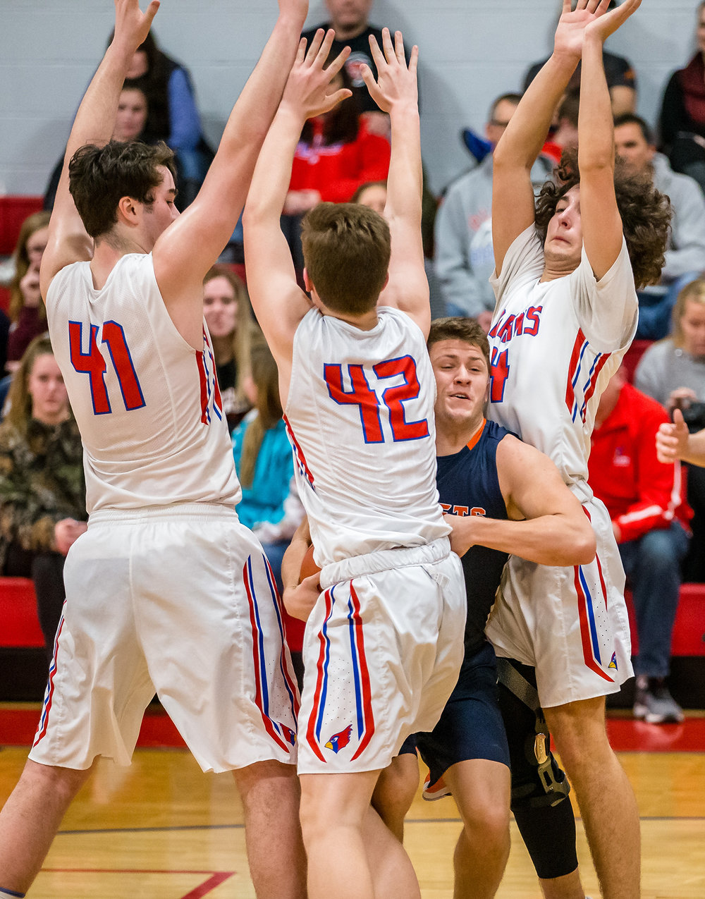 Rochester's Cade Eddington (4) draws the triple team from the Pleasant Plains defense as he drives underneath the basket in the first half at Pleasant Plains High School, Tuesday, Jan. 22, 2019, in Springfield, Ill. [Justin L. Fowler/The State Journal-Register]